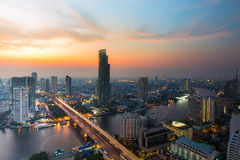 Aerial view Bangkok river cross pass city downtown with beautiful sky after sunsetSunset, dramatic sky over Bangkok city river cur Royalty Free Stock Images