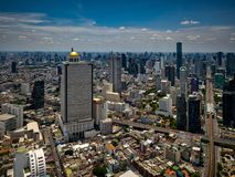 Aerial view of Bangkok skyline and skyscraper with BTS skytrain. Bangkok downtown. Panorama of Sathorn and Silom business district Bangkok Thailand with blue royalty free stock images