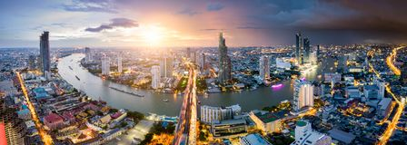 Aerial view of Bangkok skyline and skyscraper with light trails. On Sathorn Road center of business in Bangkok downtown. Panorama of Taksin Bridge over Chao royalty free stock image