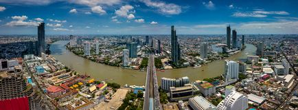 Aerial view of Bangkok skyline and skyscraper with light trails. On Sathorn Road center of business in Bangkok downtown. Panorama of Taksin Bridge over Chao stock photos