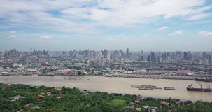 Aerial View of Bangkok skyline and view of Chao Phraya River View from green zone in Bang Krachao, Phra Pradaeng, Samut Prakan Pro. Vince. Harbors and large stock video