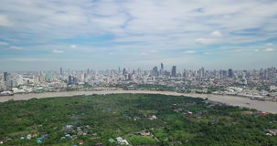 Aerial View of Bangkok skyline and view of Chao Phraya River View from green zone in Bang Krachao, Phra Pradaeng, Samut Prakan Pro. Vince. Harbors and large stock video footage