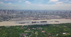 Aerial View of Bangkok skyline and view of Chao Phraya River View from green zone in Bang Krachao, Phra Pradaeng, Samut Prakan Pro. Vince. Harbors and large stock footage