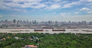 Aerial View of Bangkok skyline and view of Chao Phraya River View from green zone in Bang Krachao, Phra Pradaeng, Samut Prakan Pro stock video footage