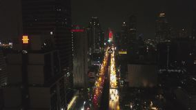Aerial view of Bangkok at twilight night. Highway traffic, city scape background. Aerial view street roundabout with car. At beautiful at night, top view 4K stock footage