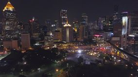 Aerial view of bangkok at twilight night. Highway Traffic, city scape background. Aerial view street roundabout with car. At beautiful at night, top view 4K stock video