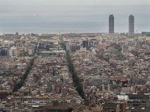 Aerial view of Barcelona, ​​Spain. With the Mediterranean Sea in the background and two skyscrapers on the skyline stock photos