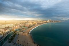Aerial view of Barcelona Beach during sunset along seaside in Ba. Rcelona, Spain. Mediterranean Sea in Spain Royalty Free Stock Photo