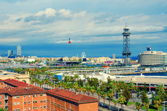Aerial view of Barcelona. La Barceloneta, Port Vell, sea and red cabin of the cableway. Catalonia, Spain.  royalty free stock images