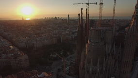 Aerial view of Barcelona with Sagrada Familia at sunset stock footage