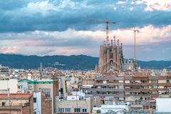 Aerial view of Barcelona skyline with Sagrada Familia under cons. Truction at sunset royalty free stock image