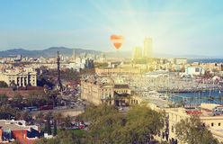 Aerial view of Barcelona, Spain at sunset with red balloon in form of heart Stock Photos