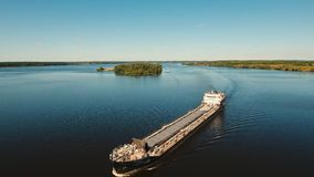 Aerial view: barge on the river. stock footage