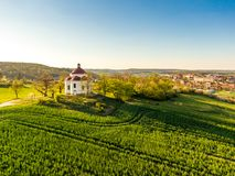 Aerial view of baroque chapel near Rosice city, Czech republic. Catholic religion building is national heritage of Czech republic. Sunny weather, agriculture stock images