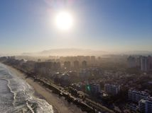 Aerial view of Barra da Tijuca beach during late afternoon with hazy sky and golden light. Rio de Janeiro, Brazil. Aerial view of Barra da Tijuca beach during royalty free stock photography