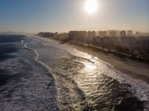 Aerial view of Barra da Tijuca beach during late afternoon with hazy sky and golden light. Rio de Janeiro, Brazil. Aerial view of Barra da Tijuca beach during royalty free stock photo