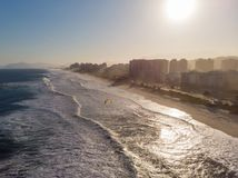 Aerial view of Barra da Tijuca beach during late afternoon with hazy sky and golden light. Rio de Janeiro, Brazil. Aerial view of Barra da Tijuca beach during stock photography