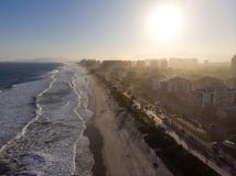 Aerial view of Barra da Tijuca beach during late afternoon with hazy sky and golden light. Rio de Janeiro, Brazil. Aerial view of Barra da Tijuca beach during stock photos