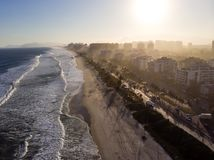 Aerial view of Barra da Tijuca beach during late afternoon with hazy sky and golden light. Rio de Janeiro, Brazil. Aerial view of Barra da Tijuca beach during stock photo