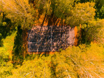 Aerial view of basketball field on day time in forest. Above with drone. Royalty Free Stock Photo