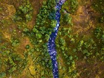 Aerial view of Batnfjorden forest with river. Direct down view over the mountains in Norway. Batnfjorden, Norway. Aerial view of Batnfjorden forest with river royalty free stock photo