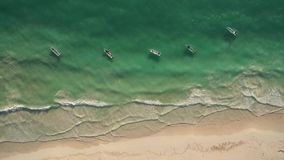Aerial view of beach and boats stock video