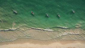 Aerial view of beach and boats stock video footage