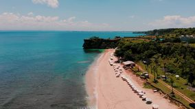 Aerial view of beach and cliff stock video footage