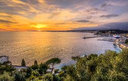 Aerial view of beach in Nice at sunset Stock Photos