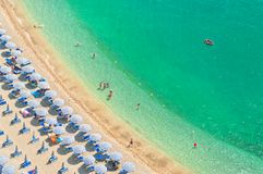 Aerial view of beach with people. Aerial view of people relaxing on beach on hot summer day on Amalfi coat, Italy Stock Image