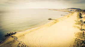 Aerial View Of A Beach. In southern france along the mediterranean coast with the city of sete in the background royalty free stock photography