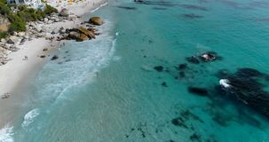 Aerial view of beach on a sunny day 4k. Aerial view of beautiful beach on a sunny day 4k stock video