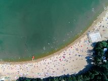 Beach with tourists. Aerial view on the beach with tourists Stock Photo