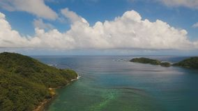 Aerial view tropical lagoon,sea, beach. Tropical island. Catanduanes, Philippines. Aerial view: beach, tropical island, bay and lagoon. Tropical landscape sky stock footage