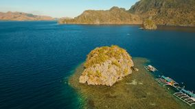 Aerial view tropical lagoon,sea, beach. Tropical island. Busuanga, Palawan, Philippines. Aerial view: beach, tropical island, sea bay and lagoon, mountains with stock video footage