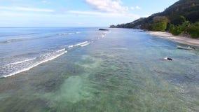 Aerial View Of Beau Vallon Beach And Rocks, Mahe Island, Seychelles 3. Drone Shot Of Beau Vallon Beach, Mahe Island, Seychelles stock footage