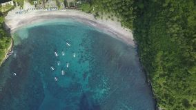 Aerial view of beautiful bay azure water of ocean. Scenic aerial view of beautiful bay with beach, white sand, azure ocean water in tropical island. View from stock footage