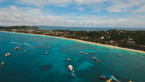Aerial view beautiful beach on tropical island. Boracay island Philippines. Aerial view of beautiful tropical island with white sand beach, hotels and tourists stock video