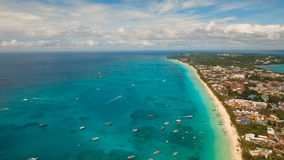 Aerial view beautiful beach on tropical island. Boracay island Philippines. Aerial view of beautiful tropical island with white sand beach and tourists. Puka stock footage