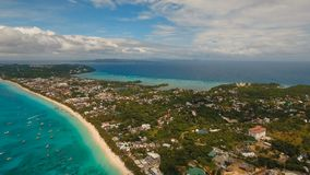 Aerial view beautiful beach on tropical island. Boracay island Philippines. Aerial view of beautiful tropical island with white sand beach, hotels and tourists stock video footage