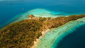 Aerial view beautiful beach on a tropical island Malcapuya. Philippines. Aerial view of tropical beach on the island Malcapuya, Palawan, Philippines. Beautiful stock footage