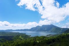 Beautiful blue sky above Batur lake and volcano Stock Photography