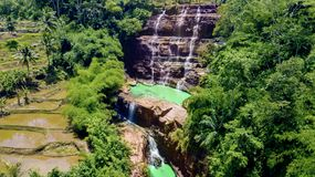 Beautiful Cigangsa waterfall near farmland Stock Photos