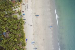 Aerial view of beautiful coastline of Indian ocean with tropical forest, sandy beach, calm blue water and fishing boats in Goa Stock Photography