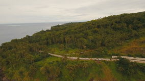 Aerial view beautiful coastline on the tropical island. Camiguin island Philippines. Aerial view coastline on tropical island with sea, trees and palms. Aerial stock footage
