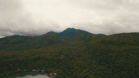 Aerial view beautiful coastline on the tropical island. Camiguin island Philippines. Aerial view coastline on tropical island with sea, trees and palms. Aerial stock video footage