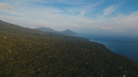Aerial view beautiful coastline on the tropical island with volcanic sand beach. Camiguin island Philippines. Aerial view coastline on tropical island with sea stock video