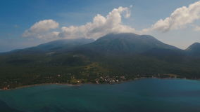 Aerial view beautiful coastline on the tropical island with volcanic sand beach. Camiguin island Philippines. stock video