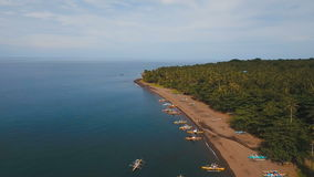 Aerial view beautiful coastline on the tropical island with volcanic sand beach. Camiguin island Philippines. Aerial view coastline on tropical island with sea stock footage