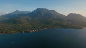 Aerial view beautiful coastline on the tropical island with volcanic sand beach. Camiguin island Philippines. stock video footage